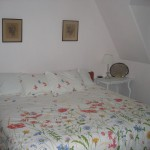 Photo: View of the king bed in bedroom 2 at Gruesome Gables