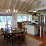 Photo: View of dining area and kitchen at Seaglass Cottage