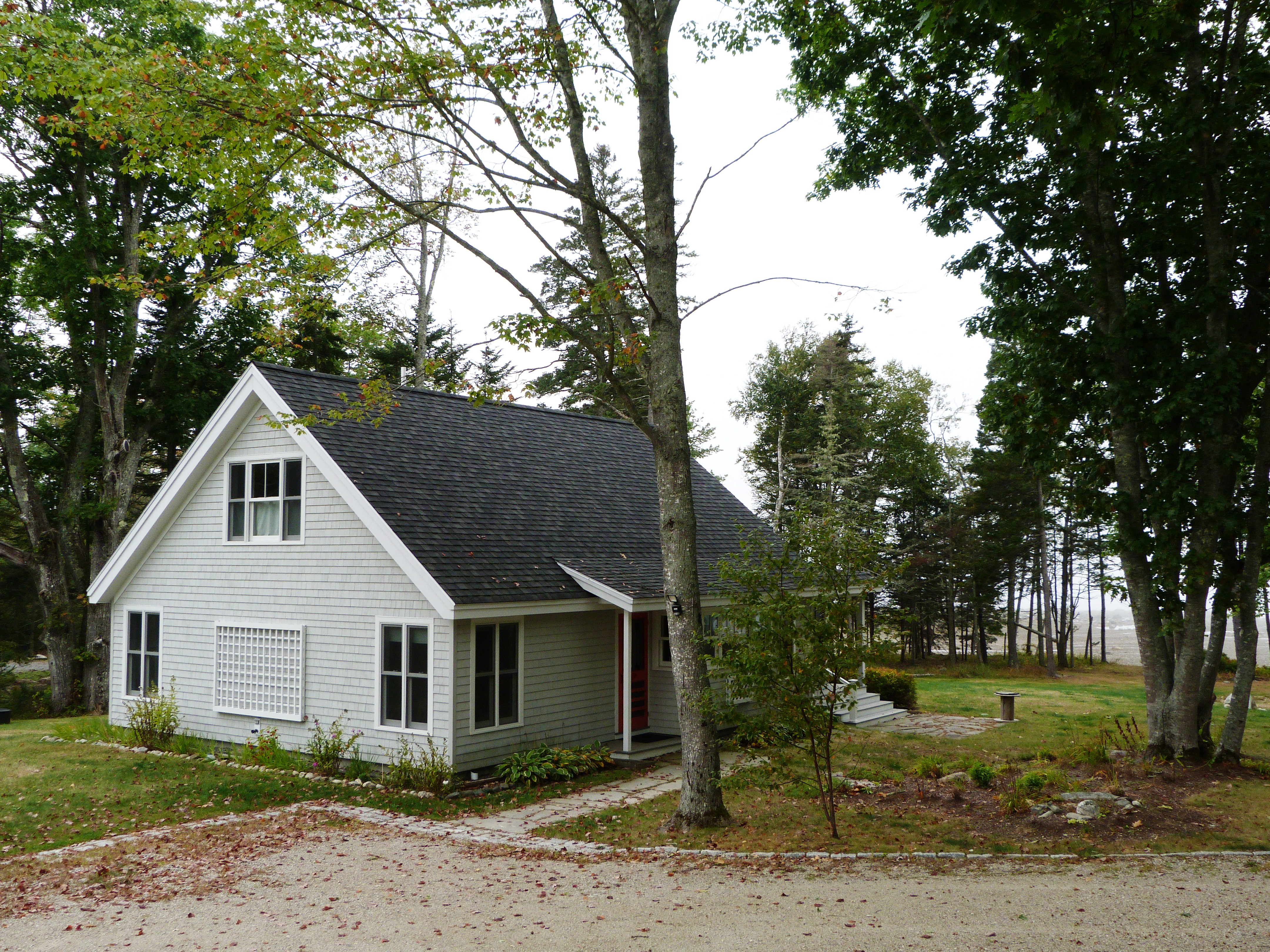 sale an in perched maine harbor for savage early cottages allowing the featured large on ledge and sunset friday me susetledge pitched southwest gable waterfront feature covered steep fred views its real over estate hillside northeast harbors with cottage