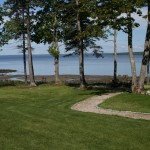 Photo: View of the lawn at Seaglass Cottage