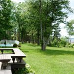 Photo: Deck and lawn view at West Winds