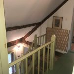 Photo:View of stairs to foyer at Nan's Caper