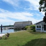 Photo: View of lawn and water at Castine Cottage