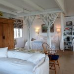 Photo: View of the bedroom area at Castine Cottage