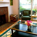 Photo: View of the fireplace in the living room at Sandpiper