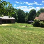 Photo: View of the lawn and garage at Nan's Caper