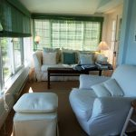 Photo: View of the enclosed porch at Quiet Harbor