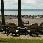 Photo: View of the outdoor seating on the lawn at Seaglass Cottage