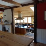 Photo: View of dining room to kitchen at Wind Whistle Farm